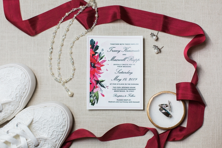 Brentwood wedding flat lay with rings invitation and tennis shoes