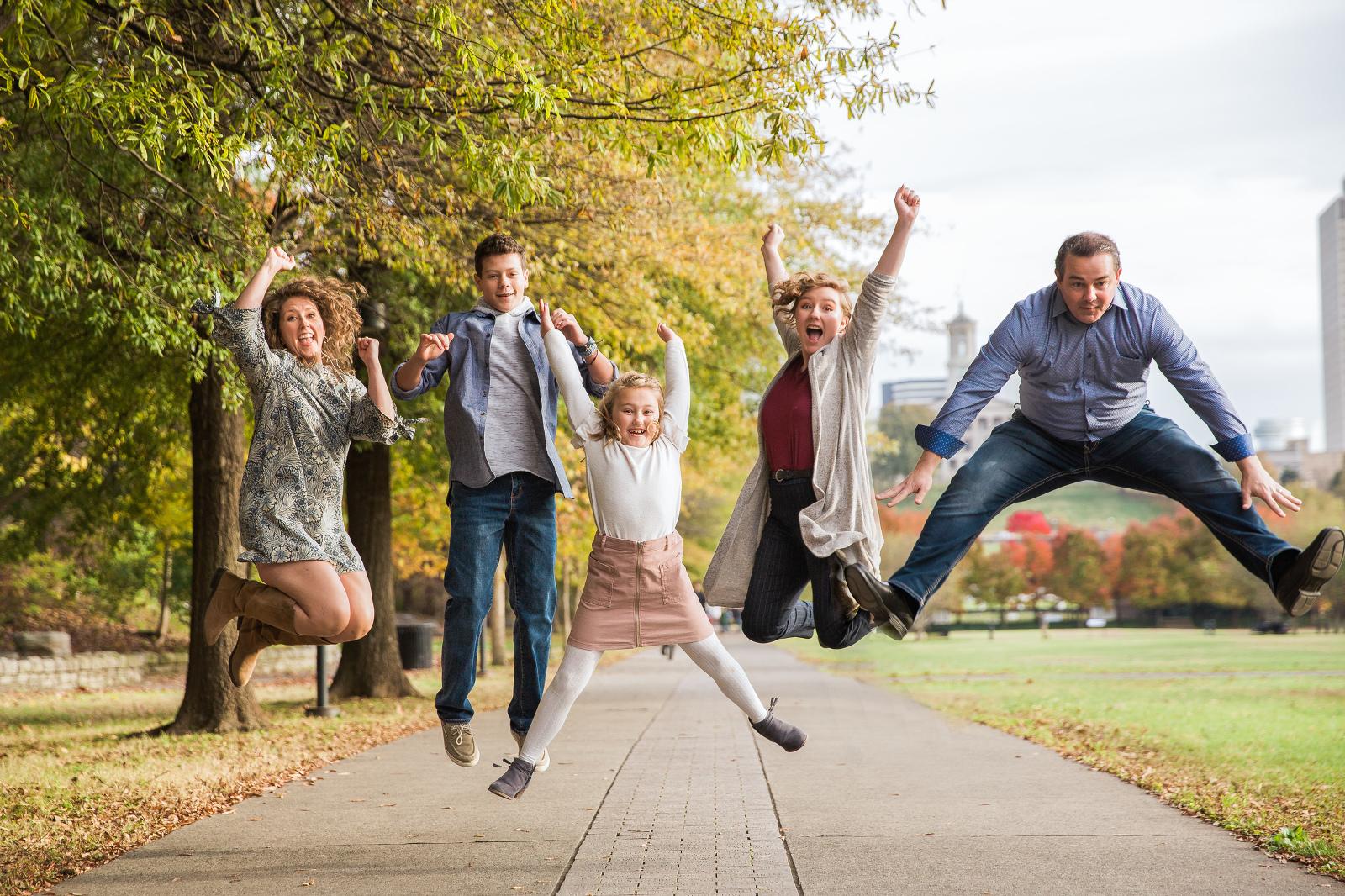 Happy family jumping in Nashville